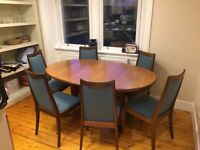 Ercol Style extending dining table and 6 newly upholstered chairs £200.