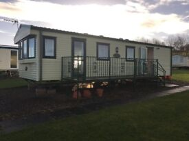 Cheap Caravan in Scotland, Double Glazed & Central Heated, Sleeps 6 and is Decked