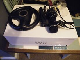 Used wii Mario Kart edition includes extra controllers - excellent condition - boxed with manuals