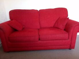 Sofa bed, red chenille, strong metal action, slight wear to one arm (see photo). COLLECTION ONLY.