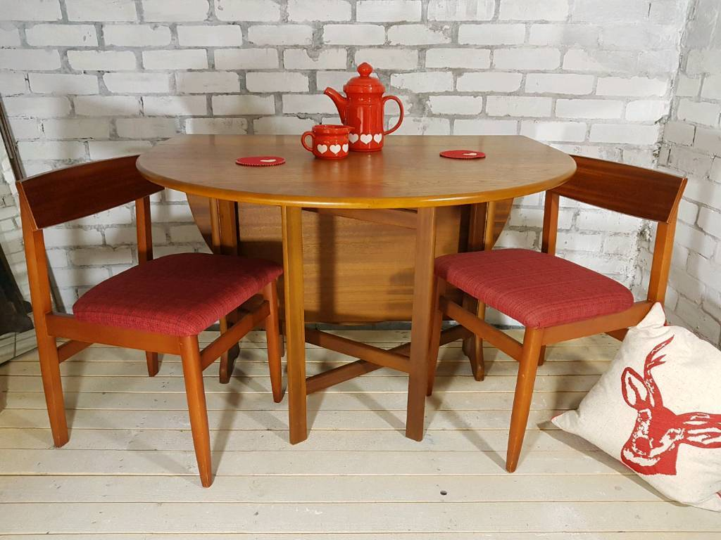 Gorgeous vintage G Plan gateleg, drop leaf oval table with 4 teak & fabric chairs