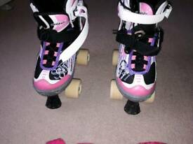 Roller skate boots and knee and elbow pads