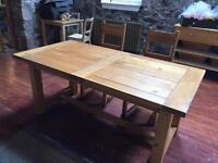 Oak extending dinning table and 4 chairs