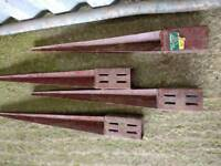 Four metal fence posts supports
