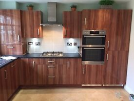 Fitted Kitchen finished in Walnut high gloss and appliances fridge hob etc