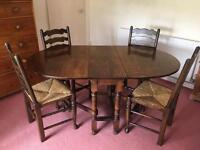 VINTAGE OAK OVAL GATE LEGGED DROP LEAF DINING TABLE & FOUR RATTAN-SEAT LADDER-BACK CHAIRS