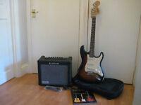 Sunburst Stratocaster electric guitar and amp