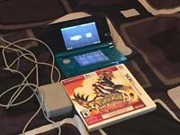 Aqua blue 3DS with charger, pen, & game