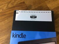 Kindle -- new in sealed package £40 ono