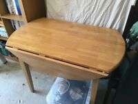 Dining table extending - round. approx 110cm wide