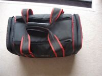 A HOLDALL-STYLE CAMERA CASE - PADDED PROTECTIVE LINED COMPARTMENTS.