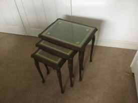 """NEST OF GLASS TOPPED TABLES .The largest of three measures H21"""" L 21"""" D 16"""""""