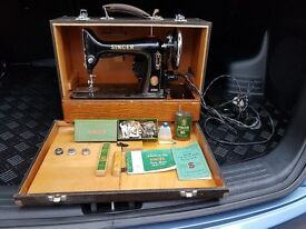 Vintage Singer Sewing Machine and Accessories in a case