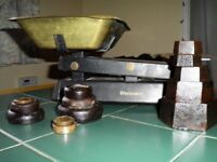 Food weighing scales brass weighing pan and black metal with imperial and metric weights.