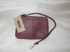 A Genuine Rasberry Wilson Leather Black Rivet Cashwrap Wristlet Bag