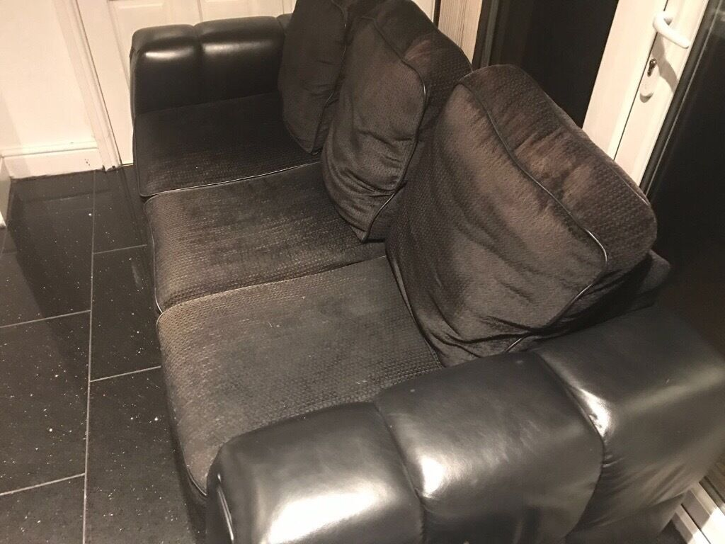 Part leather black sofa