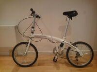 Landrover folding bike with bag, bike lock, helmet and manual.
