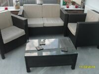 Black rattan 3 pc suite, glasstop coffee table & footstall