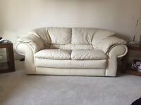 Two and three seater cream leather sofa