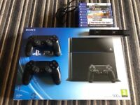 PlayStation 4 with various games