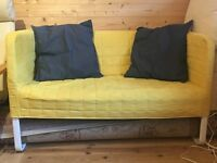 Yellow sofa/couch from IKEA, with washable cover and 2 pillows.