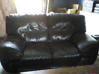 Black leather settees.