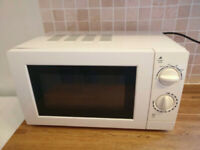 White Microwave. Model: GMM101W George Home