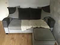 Grey DFS sofa bed and foot stool