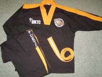 UKTC Active Tigers suit size 0 to fit 130cm. £43 new official gear. Black and orange