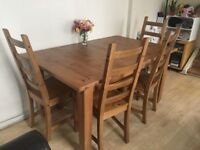 4 person pine table extends to a 6 person includes 4 chairs