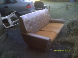 A PERFECTLY RESPECTABLE 3 SEATER SETTEE , NO RIPS or TEARS & CLEAN with 3 CUSHIONS .