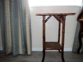 Table with bamboo legs and wicker type top