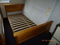 WOODEN DOUBLE BED WITH MATTRESS IN EXCELLENT CONDTION, NO DAMAGES OR RIPS.