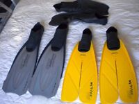 Three pairs of assorted flippers.