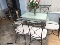 Large glass dining table & 6 chairs - striking design !!