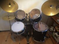 8 piece custom drum kit. Excellent condition complete with dw5000 bass foot pedal and drumsticks