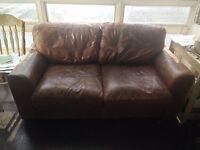 Beautifully comfortable italian leather 2 seater sofa