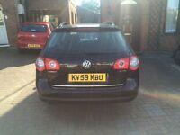 Black VW Passat estate