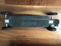 Evolve Carbon Electric Skateboard with All terrain & Street setups. Excellent condition