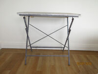 Grey/beige wooden top table with wrought iron frame great as a bedside table