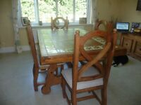 Solid wood heavy duty dining table and 4 chairs
