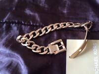 Authentic gold Michael Kors belt and buckle bracelet