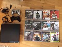 Sony PS3 Slimline 320GB - 2 controllers - 12 games
