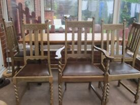 Solid Oak Dining Table and 6 chairs inc. 1 carver. Beautifully restored ,excellent condition.