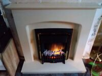 Electric fireplace with beige surround