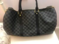 Louis Vuitton Keepall Holdall Bag in Black