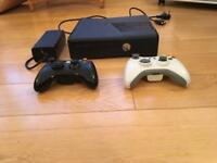 Xbox 360 S, 4GB hard drive, 2 controllers, 21 games, original box