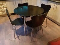 Set of 4 table and chairs.