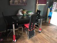 Black glass table with 3 chairs