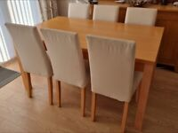 Dining table and 6 chairs good condition can deliver